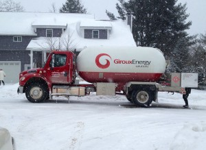 Giroux Energy Propane truck delivering to a residential customer